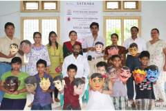 Group photograph from mask making workshop, 2014