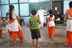 Shri Pabitrapran Bora imparting theoretical knowledge to the participants during Ankiya Bhaona workshop, 2014
