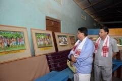Sri Surjya Hazarika and Sri Sankar Prasad Kakoti Bora viewing painting by artist Manika Das